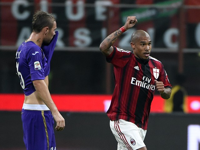 AC Milan's midfielder from Netherlands Nigel de Jong celebrates after scoring during the Italian Serie A football match AC Milan vs Fiorentina on October 26, 2014
