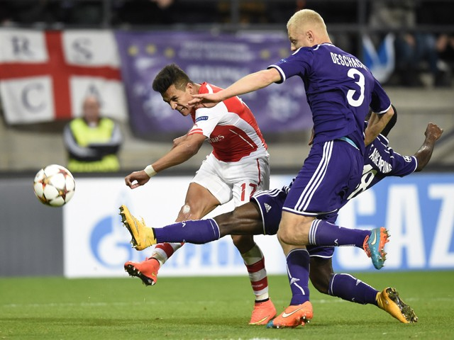 Arsenal's Chilean striker Alexis Sanchez has a shot on goal past Anderlecht's defender Olivier Deschacht during a UEFA Champions League group stage football match Anderlecht vs Arsenal at the Constant Vanden Stock stadium in Anderlecht on October 22, 2014