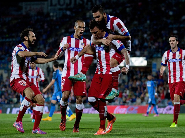Mario Mandzukic of Atletico de Madrid celebrates scoring their opening goal with teammates Arda Turan (R), Joao Miranda (2ndL) and Juan Francisco Torres alias Juanfran the La Liga match between Getafe CF and Club Atletico de Madrid at Coliseum Alfonso Per