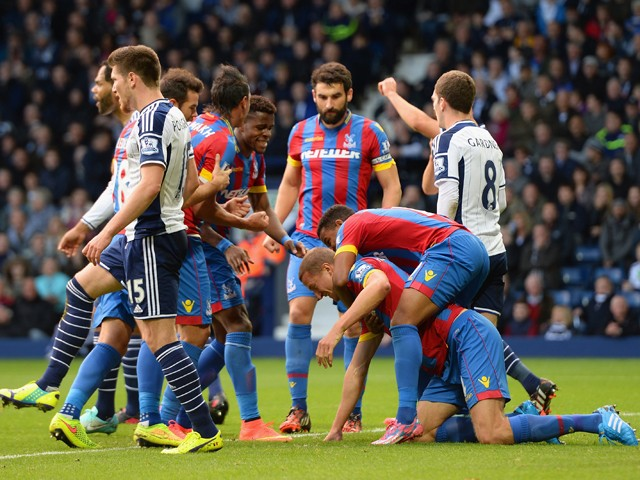 Brede Hangeland of Crystal Palace is mobbed by team mates after scoring the opening goal during the Barclays Premier League match between West Bromwich Albion and Crystal Palace at The Hawthorns on October 25, 2014