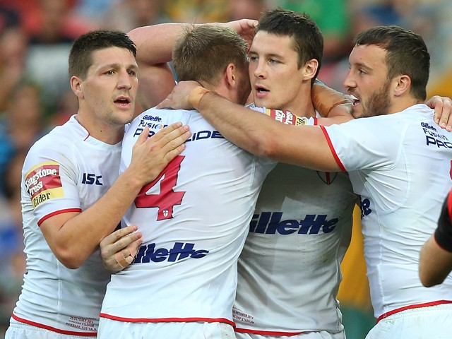 Joel Tomkins of England celebrates a try with team mates during the Four Nations match between England and Samoa at Suncorp Stadium on October 25, 2014