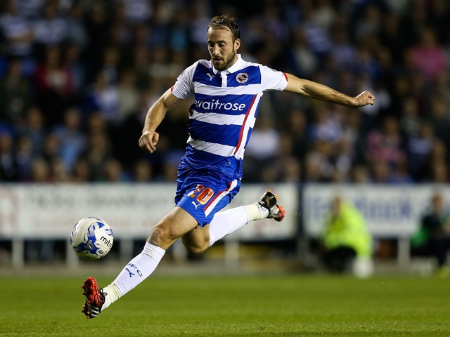 Glenn Murray of Reading in action during the Sky Bet Championship match between Reading and Millwall at Madejski Stadium on September 16, 2014