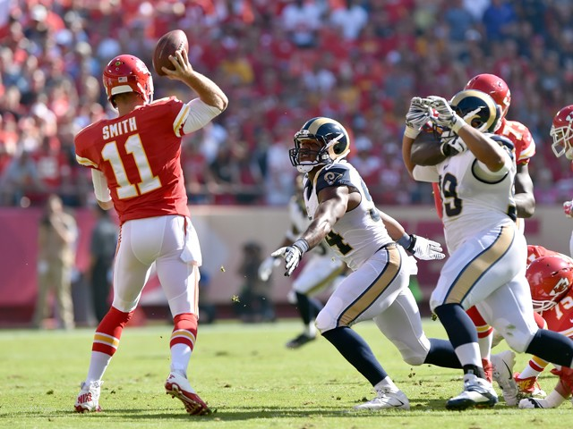 Alex Smith #11 of the Kansas City Chiefs passes against the St. Louis Rams during the first half at Arrowhead Stadium on October 26, 2014