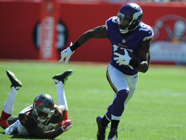 Wide receiver Greg Jennings #15 of the Minnesota Vikings carries the ball past cornerback Johnthan Banks #27 of the Tampa Bay Buccaneers in the second quarter at Raymond James Stadium on October 26, 2014