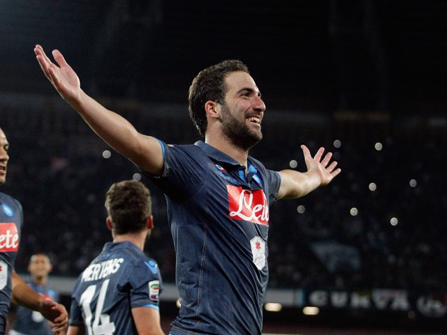 Gonzalo Higuain of Napoli celebrates after scoring his third goal during the Serie A match between SSC Napoli and Hellas Verona FC at Stadio San Paolo on October 26, 2014