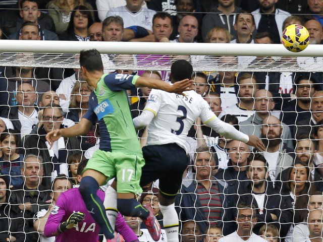 Newcastle United's Spanish striker Ayoze Perez jumps to score their second goal from this header during the English Premier League football match between Tottenham Hotspur and Newcastle United at White Hart Lane in north London on October 26, 2014