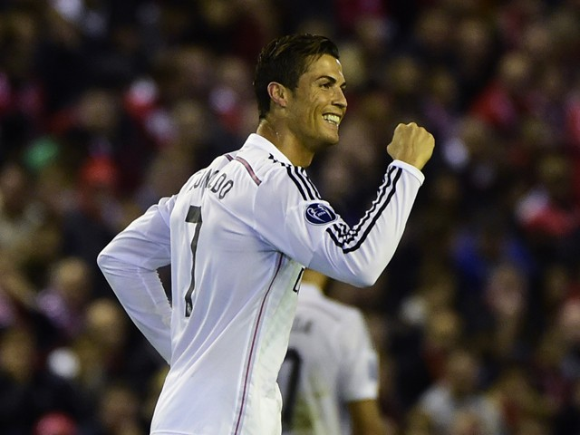 Real Madrid's Portuguese forward Cristiano Ronaldo celebrates scoring the opening goal during the UEFA Champions League, group B, football match between Liverpool and Real Madrid at Anfield in Liverpool, northwest England, on October 22, 2014