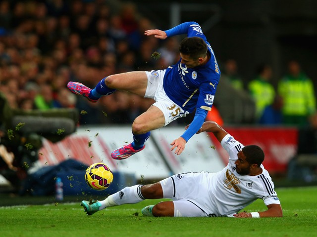 Ashley Williams of Swansea City tackles David Nugent of Leicester City during the Barclays Premier League match between Swansea City and Leicester City at Liberty Stadium on October 25, 2014
