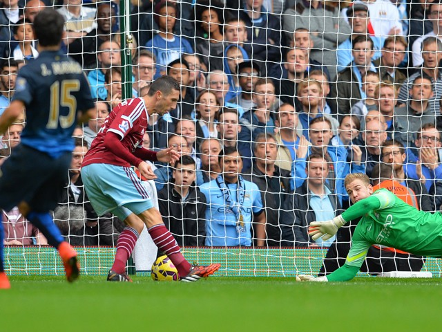 West Ham United's French midfielder Morgan Amalfitano turns the ball in to score the opening goal past the diving Manchester City's English goalkeeper Joe Hart during the English Premier League football match between West Ham United and Manchester City at