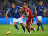 Daniel Drinkwater of Leicester City holds off a challenge from James Morrison of West Brom during the Barclays Premier League match on November 1, 2014