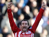 Danny Higginbotham of Stoke City celebrates victory after the FA Cup sponsored by E.ON 6th Round match between Stoke City and West Ham United at the Britannia Stadium on March 13, 2011