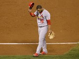 Oscar Taveras #18 of the St. Louis Cardinals tips his hat as he walks off the field after the Cardinals lose to the San Francisco Giants 6-3 during Game Five of the National League Championship Series at AT&T Park on October 16, 2014