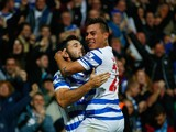 Charlie Austin of QPR celebrates scoring their second goal with Eduardo Vargas of QPR during the Barclays Premier League match between Queens Park Rangers and Aston Villa at Loftus Road on October 27, 2014