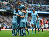 Sergio Aguero of Manchester City is mobbed by team mates a