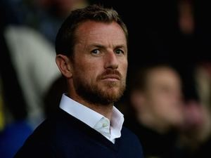 Burton manager Gary Rowett looks on prior to the Capital One Cup Second Round match between Burton Albion and Queens Park Rangers at Pirelli Stadium on August 27, 2014