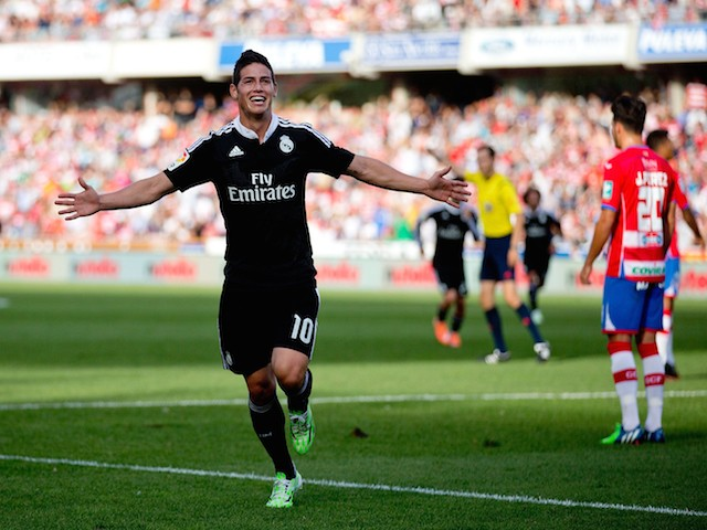 James Rodriguez of Real Madrid CF celebrates scoring their second goal during the La Liga match against Granada on November 1, 2014