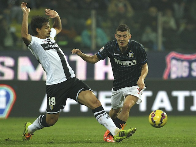 Mateo Kovacic (R) of FC Internazionale Milano competes for the ball with Dias Da Silva Dal Belo Felipe (L) of Parma FC during the Serie A match on November 1, 2014