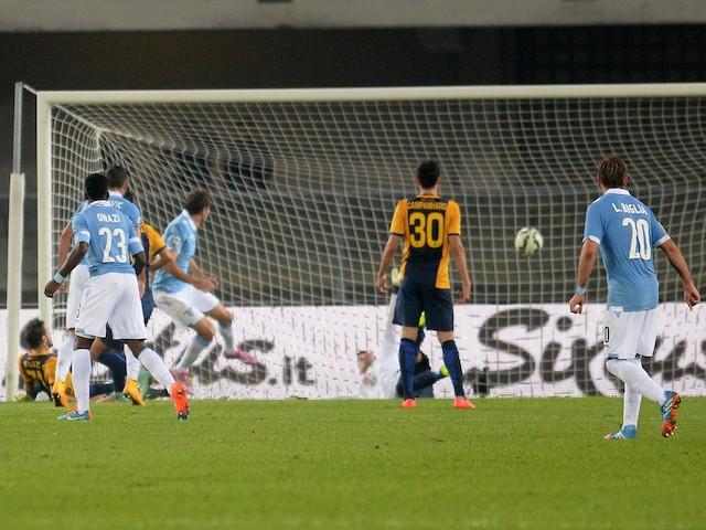 Senad Lulic (C) of Lazio scores his opening goal during the Serie A match between Hellas Verona FC and SS Lazio at Stadio Marc'Antonio Bentegodi on October 30, 2014