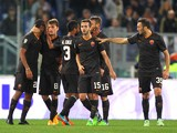 Adem Ljaijc (2nd-L) of AS Roma with his teammates celebrates after scoring the third team's goal during the Serie A match between AS Roma and Torino on November 9, 2014