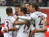 Bayern's players celebrate teammate Thomas Muller scoring the 1-0 during the German first division Bundesliga football match Eintracht Frankfurt vs FC Bayern Munich in Frankfurt am Main, central Germany, on November 8, 2014
