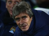 Manuel Pellegrini manager of Manchester City looks on prior to the Barclays Premier League match between Queens Park Rangers and Manchester City at Loftus Road on November 8, 2014