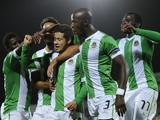 Rio Ave's Brazilian midfielder Diego Lopes celebrates with his teammates after scoring during the UEFA Europa League football match Rio Ave FC vs FC Steaua Bucharest at the Arcos stadium in Vila do Conde on November 6, 2014