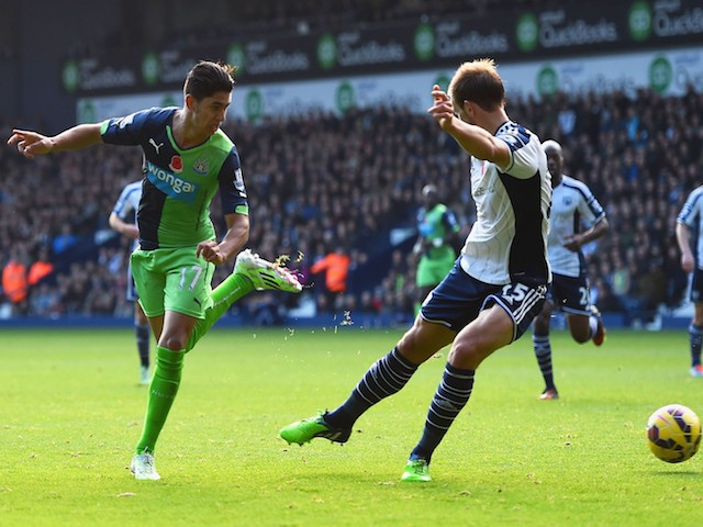 Ayoze Perez of Newcastle United (R) beats Craig Dawson of West Bromwich Albion to score their first goal during the Barclays Premier League match on November 9, 2014