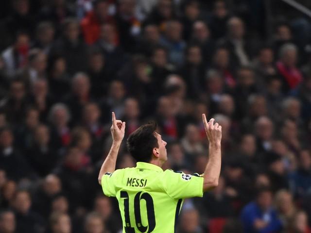 Barcelona's Argentinian forward Lionel Messi celebrates after scoring during the UEFA Champions League football match between Ajax Amsterdam and FC Barcelona in Amsterdam, November 5, 2014