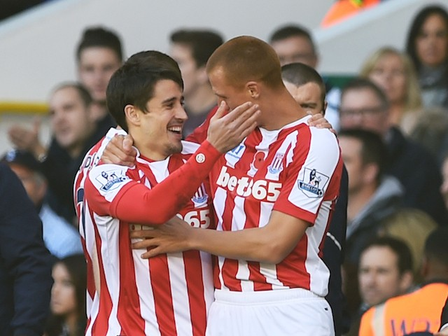 Bojan Krkic (L) of Stoke City celebrates with teammate Steve Sidwell of Stoke City after scoring the opening goal during the Barclays Premier League match against Spurs on November 9, 2014