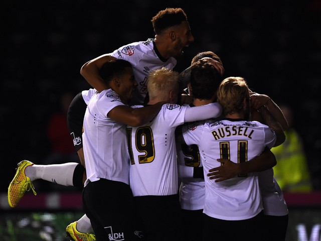 Jordon Ibe of Derby County is mobbed after scoring the first goal during the Sky Bet Championship match between Derby County and Huddersfield Town at iPro Stadium on November 4, 2014