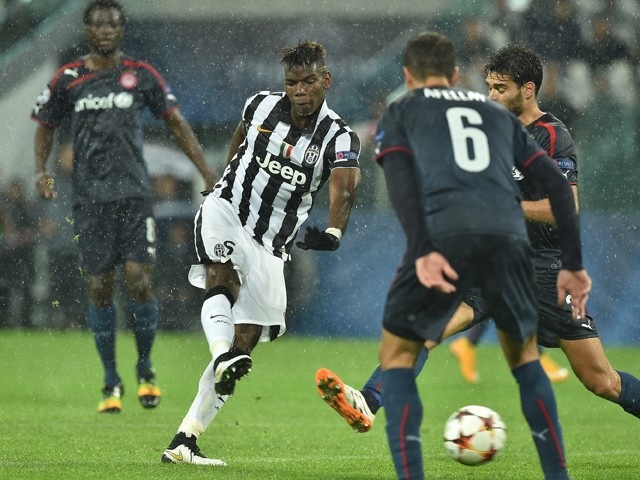 Paul Pogba of Juventus scores their third goal during the UEFA Champions League group A match between Juventus and Olympiacos FC at Juventus Arena on November 4, 2014
