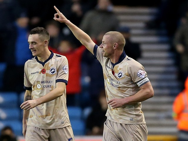 Alan Dunne celebrates after he scores to make it 2-2 during the Sky Bet Championship match between Millwall and Brentford at The Den on November 8, 2014
