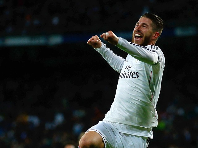 Sergio Ramos of Real Madrid CF celebrates scoring their second goal during the La Liga match between Real Madrid CF and Rayo Vallecano de Madrid at Estadio Santiago Bernabeu on November 8, 2014