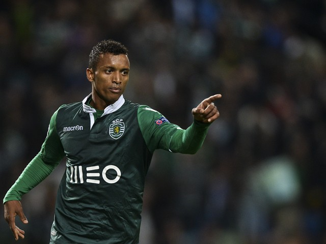 Sporting's midfielder Nani celebrates after scoring during the UEFA Champions League football match Sporting Clube de Portugal vs FC Schalke 04 at the Jose Alvalade stadium in Lisbon on November 5, 2014
