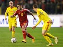 Eden Hazard of Belgium runs at Chris Gunter of Wales during the Group B UEFA European Championship 2016 Qualifier match on November 16, 2014