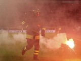A fireman picks up fireworks during the EURO 2016 Group H Qualifier match between Italy and Croatia at Stadio Giuseppe Meazza on November 16, 2014