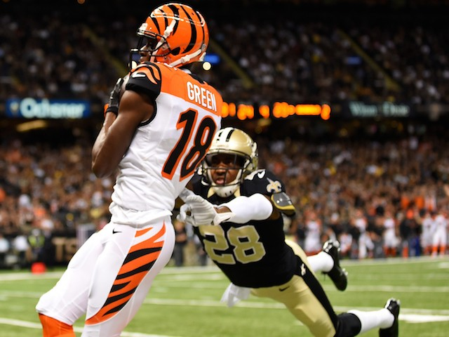 A.J. Green #18 of the Cincinnati Bengals catches a touchdown pass as Keenan Lewis #28 of the New Orleans Saints tries to defend on November 16, 2014