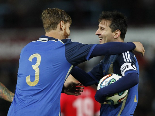 Argentina defender Christian Ansaldi celebrates after scoring an equalising goal with Argentina striker Lionel Messi during the international friendly football match between Croatia and Argentina at the Boleyn Ground, Upton Park, in London on November 12,