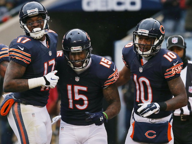 Brandon Marshall of the Chicago Bears (center) celebrates his touchdown with Alshon Jeffery and Marquess Wilson during a game against the Vikings on November 16, 2014