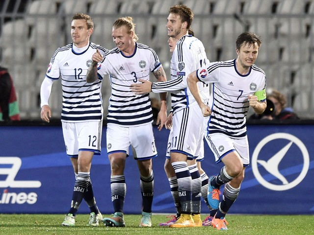 Denmark's defender Simon Kjaer celebrates with his teammates after scoring a goal during the Euro 2016 group I qualifying football match between Serbia and Denmark in Belgrade on November 14, 2014