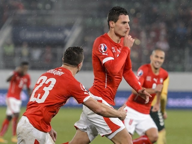 Switzerland's defender Fabian Schaer (2ndR) celebrates after scoring the team's second goal during the Euro 2016 Group E qualifying match against Lithuania on November 15, 2014