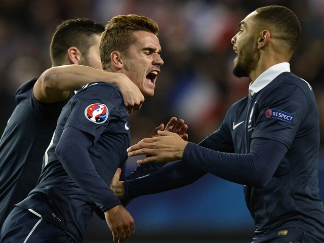 French forward Antoine Griezmann is congratulated by teammates after scoring during the friendly football match France vs Albania on November 14, 2014
