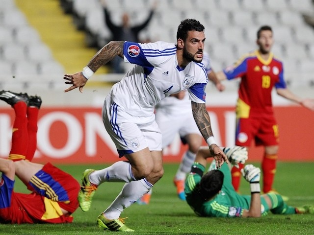 Cypriot player Giorgos Merkis (C) celebrates scoring a goal during their Euro 2016 Group B qualifying match against Andorra at the GSP Stadium in the capital Nicosia on November 16, 2014
