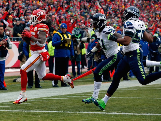 Jamaal Charles #25 of the Kansas City Chiefs scores a touchdown against Bruce Irvin #51 and K.J. Wright #50 of the Seattle Seahawks on November 16, 2014