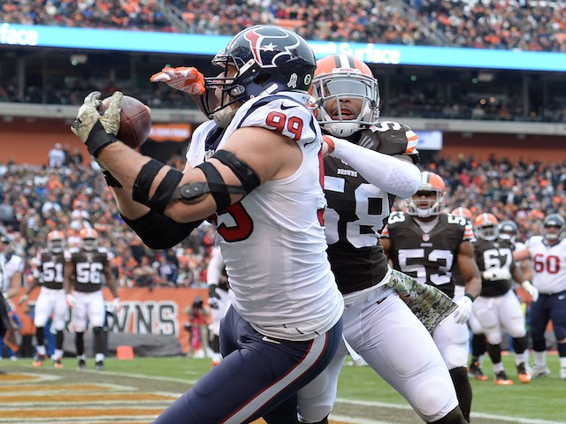 J.J. Watt #99 of the Houston Texans makes a touchdown catch in front of Chris Kirksey #58 of the Cleveland Browns on November 16, 2014