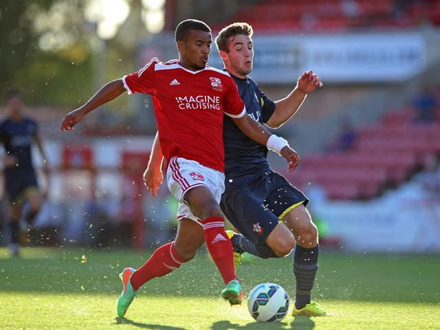 Nathan Thompson of Swindon in action with Sam McQueen of Southampton during the Pre Season Friendly between Swindon Town and Southampton on July 21, 2014