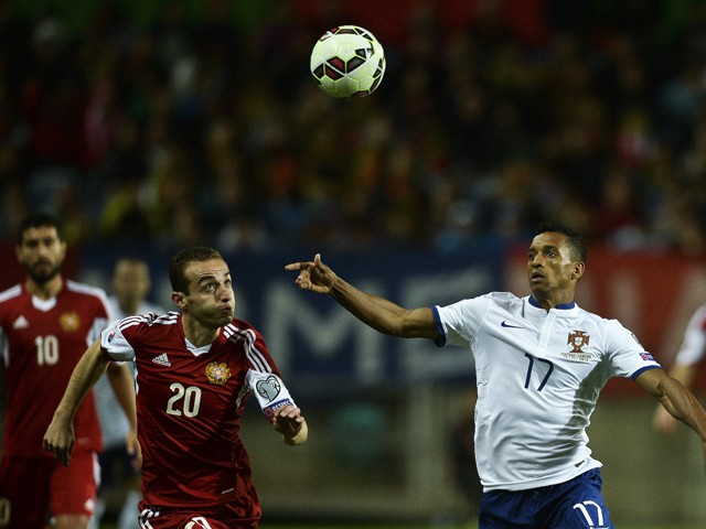 Portugal's forward Nani vies with Armenia's defender Levon Ayrapetyan during the UEFA Euro 2016 Qualifier, Group I football match Portugal vs Armenia at the Algarve Stadium in Faro on November 14, 2014