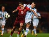 Danny of Portugal and Nicolas Otamendi of Argentina battle for the ball during the International Friendly between Argentina and Portugal at Old Trafford on November 18, 2014