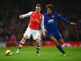Calum Chambers of Arsenal and battle for the ball Marouane Fellaini of Manchester United during the Barclays Premier League match between Arsenal and Manchester United at Emirates Stadium on November 22, 2014