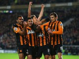 Jake Livermore of Hull City is mobbed by team mates after scoring the opening goal during the Barclays Premier League match between Hull City and Tottenham Hotspur at KC Stadium on November 23, 2014